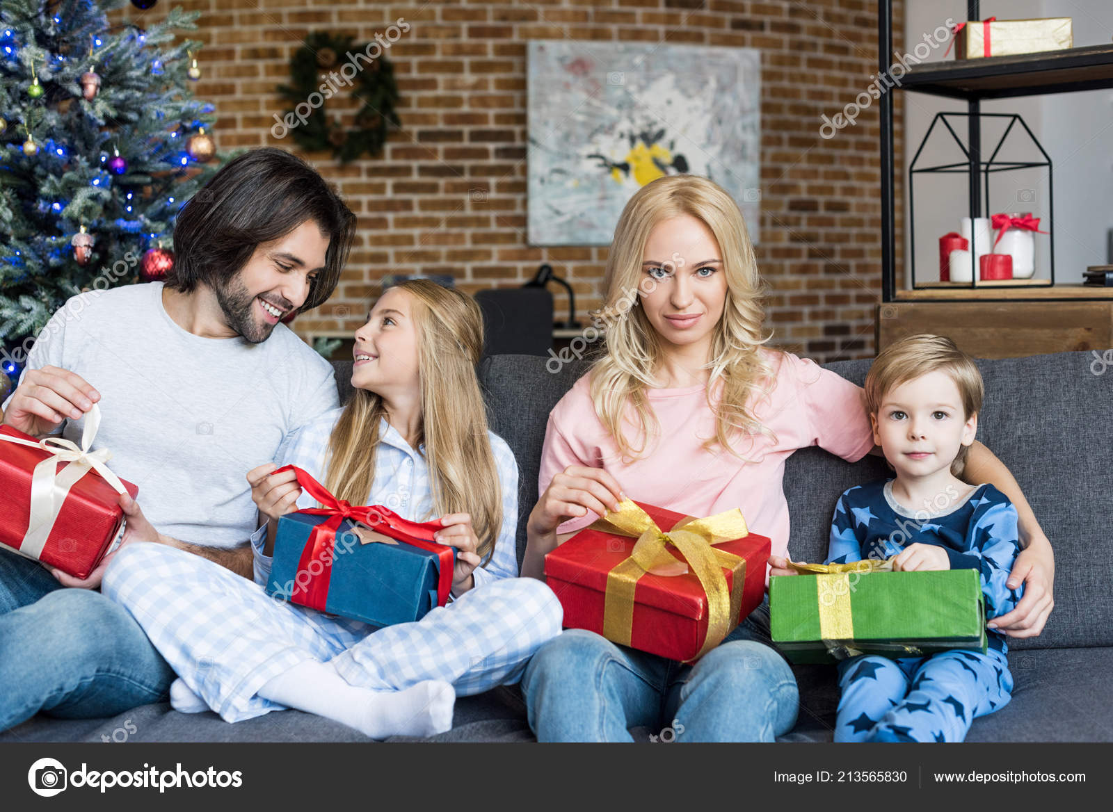 Beautiful Happy Family Two Kids Holding Christmas Gifts Sitting ...