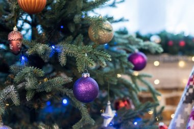 close-up view of christmas tree decorated with beautiful shiny colorful baubles