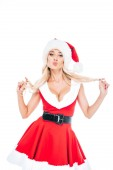 attractive woman in santa dress and christmas hat doing duck face isolated on white background