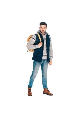 full length view of handsome young man with backpack looking at camera isolated on white