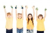 Fotografie adorable happy kids showing hands in paint and smiling at camera isolated on white