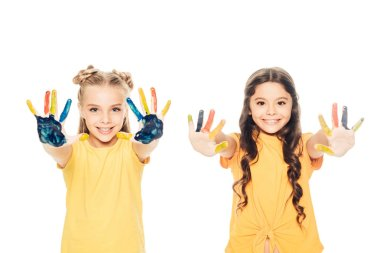 Beautiful happy children showing colorful painted hands and smiling at camera isolated on white stock vector