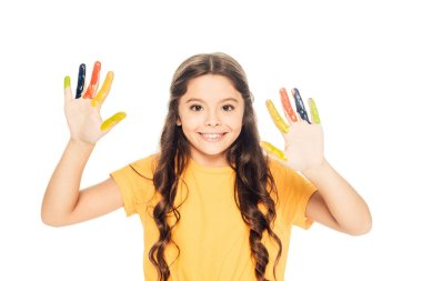Beautiful happy kid showing colorful painted hands and smiling at camera isolated on white stock vector