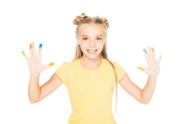Adorable child showing colorful painted hands and smiling at camera isolated on white stock vector