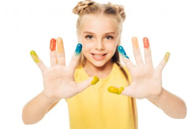 Happy child showing colorful painted hands and smiling at camera isolated on white stock vector