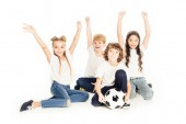 Photo happy kids with soccer ball raising hands and smiling at camera isolated on white