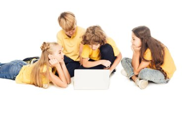 group of adorable children using laptop together isolated on white