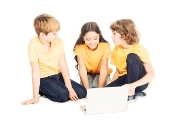 cute smiling kids using laptop together isolated on white