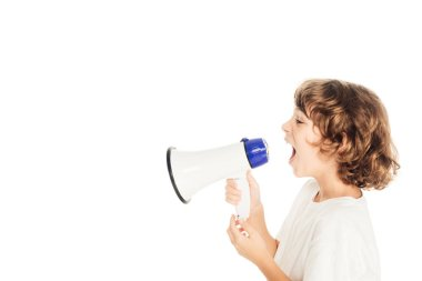 side view of cute little boy yelling in megaphone isolated on white