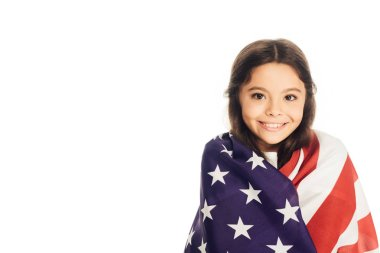 Smiling adorable kid wrapped in american flag looking at camera isolated on white stock vector