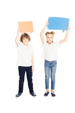 cheerful adorable children holding paper speech bubbles above heads isolated on white
