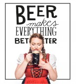 Fotografie oktoberfest waitress in traditional bavarian dress drinking dark beer isolated on white background with beer makes everything better inspiration