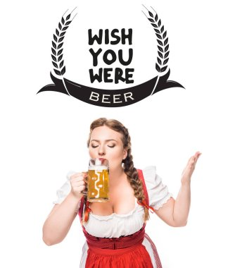 oktoberfest waitress in traditional bavarian dress drinking light beer isolated on white background with