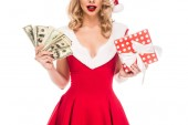 Fotografie partial view of santa girl in christmas hat holding cash money and gift box isolated on white