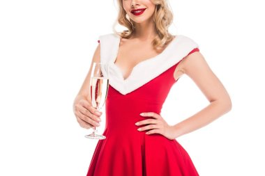 partial view of young woman in christmas dress holding champagne glass isolated on white
