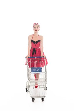 young pin up woman carrying shopping cart isolated on white