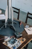 rocket model and microcircuit on table in kitchen