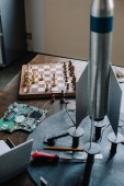 Photo chess board and rocket model on table in living room