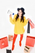 Photo attractive girl with megaphone and shopping bags for black friday isolated on white