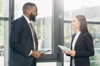 multiracial business colleague discussing lecture in conference hall