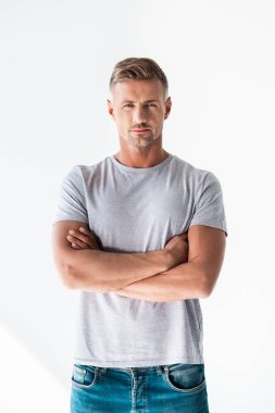 Handsome adult man in blank grey t-shirt looking at camera with crossed arms isolated on white stock vector