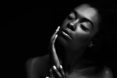 black and white photo of beautiful african american woman isolated on black