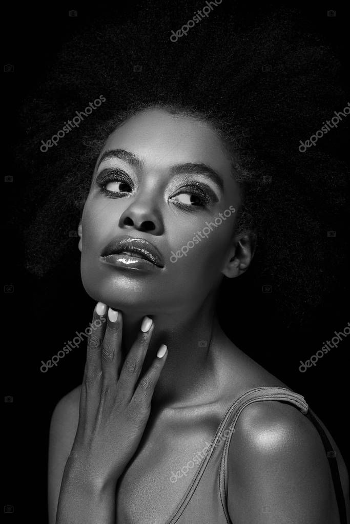 Black and white photo of beautiful pensive african american woman isolated on black stock vector