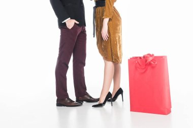 partial view of couple and shopping bags isolated on white