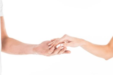 Partial view of people tenderly holding hands isolated on white stock vector