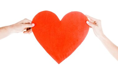 Partial view of people holding big red heart isolated on white