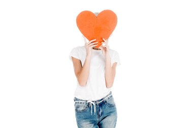 Woman in white t-shirt holding red big heart shape in front of face isolated on white stock vector