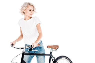 Wonderful blonde young adult woman riding bicycle isolated on white