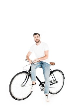 Handsome smiling man riding bicycle isolated on white