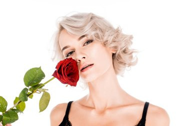 Amazing blonde woman holding beautiful red rose isolated on white