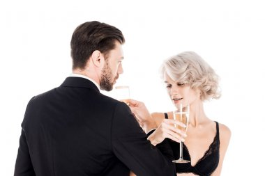 Attractive couple clinking glasses of champagne isolated on white