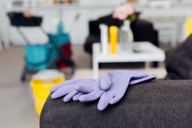 Close up of rubber gloves on sofa with blurred background stock vector