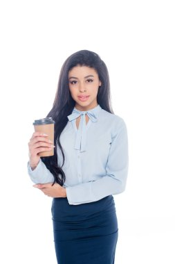 beautiful young african american businesswoman holding coffee to go and looking at camera isolated on white