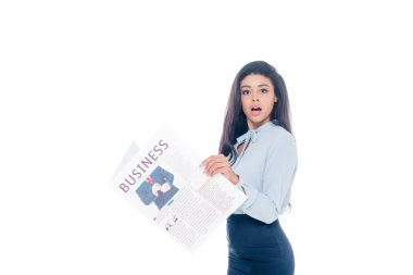 shocked young african american woman holding business newspaper and looking at camera isolated on white