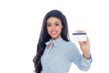 Young african american businesswoman holding credit card and smiling at camera isolated on white stock vector