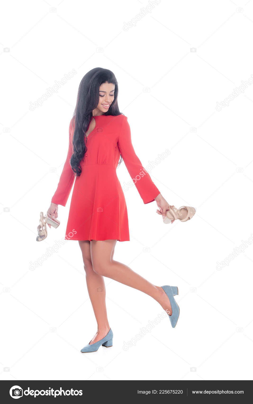 0cc01ae61d5d Attractive african american girl in red dress holding sandals with heels  isolated on white — Photo by ...