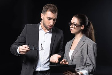 business people with clipboard having conversation isolated on black