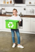 Photo smiling child holding green recycle box at kitchen