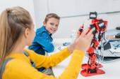 Fotografie schoolchildren programming robot together during STEM educational class