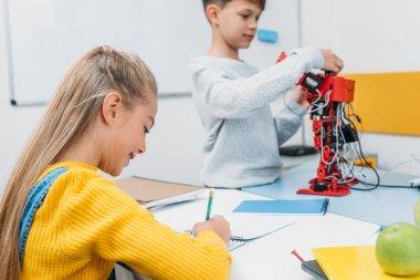 children working on task at STEM robotics lesson