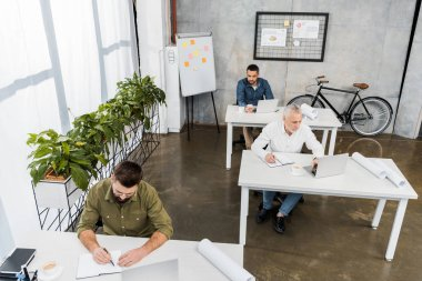 high angle view of professional businessmen working in office