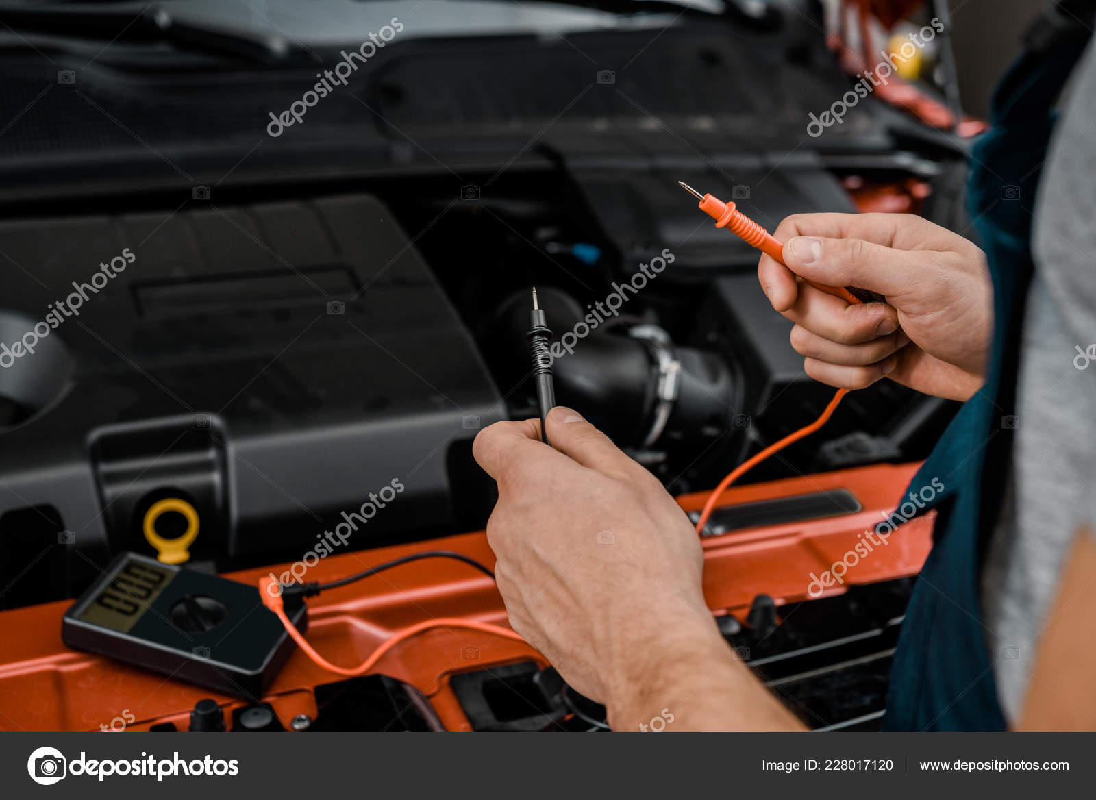 Car Battery Voltage >> Cropped Shot Auto Mechanic Multimeter Voltmeter Checking Car Battery