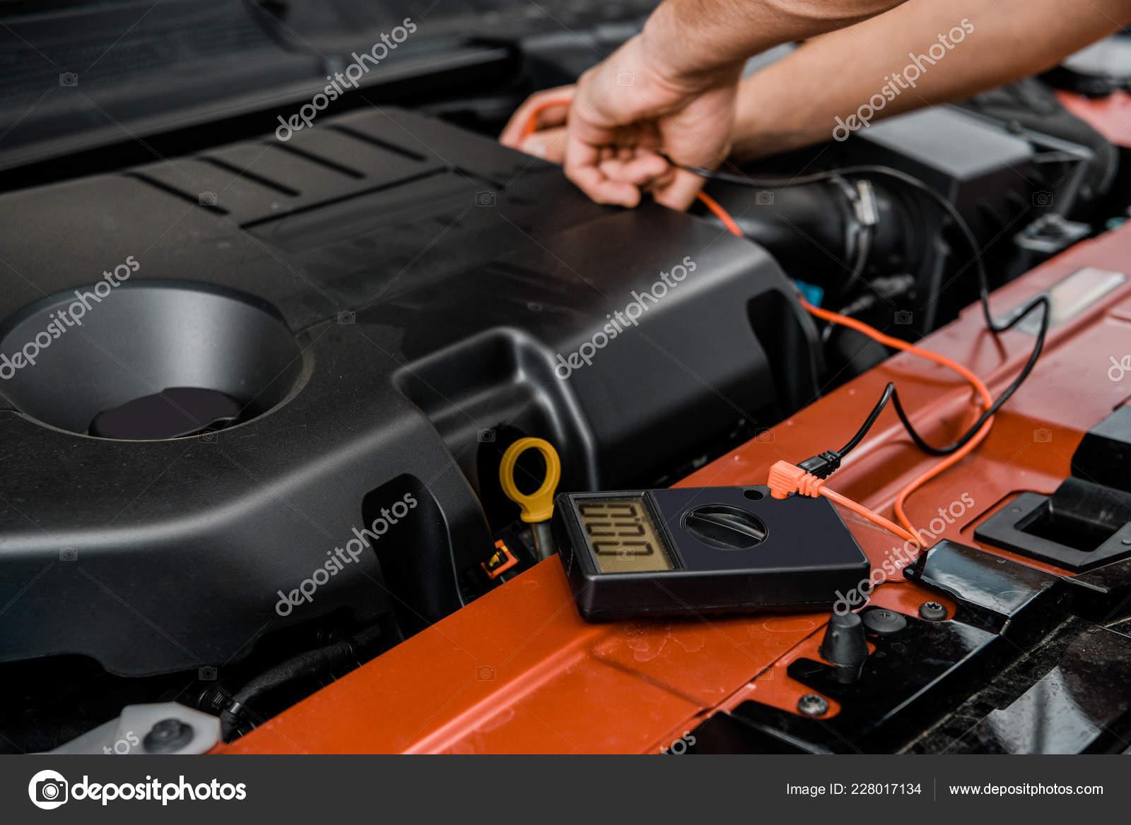 Partial View Auto Mechanic Multimeter Voltmeter Checking Car Battery