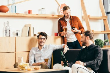 friends with beer spending time together in cafe