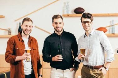 Portrait of smiling men with beer in hands looking at camera in cafe stock vector