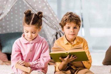 Adorable little children reading books together stock vector